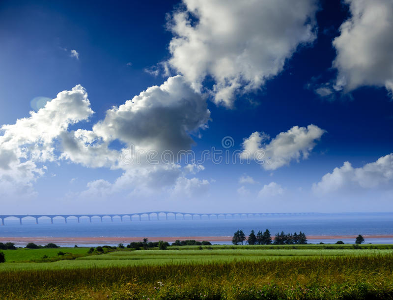 Confederation Bridge. At Prince Edward Island, Canada with a hay field in foreground stock image