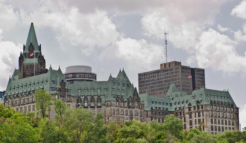 Confederation Politics. The canadian Parliament Confederation Building facing the Ottawa river in Ottawa, Canada royalty free stock photography