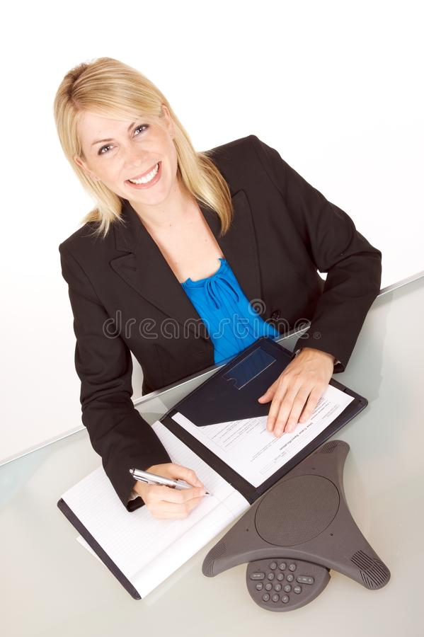 Conference Call. Attractive young business woman on a conference call royalty free stock photos