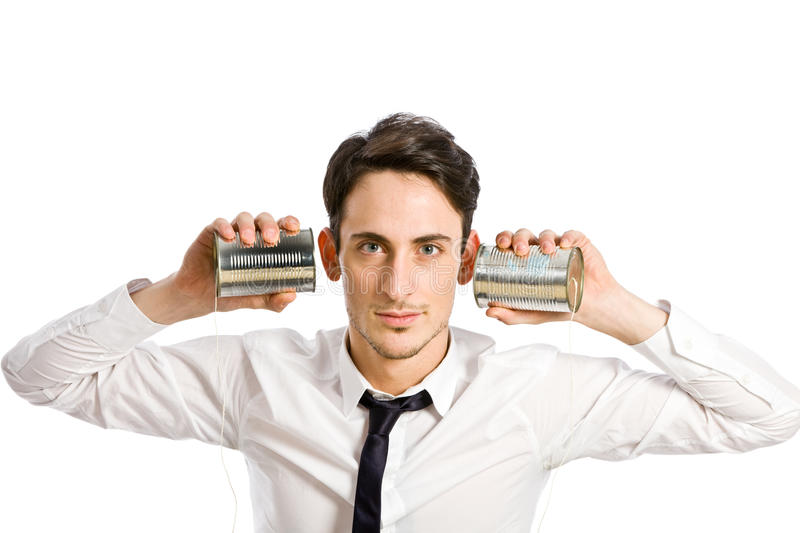 Conference Call. Conceptual photo of man with two tin phones simulating conference call royalty free stock images