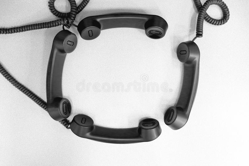 Conference Call theme using phone headsets. Telephone headsets arranged in a conference call theme royalty free stock images