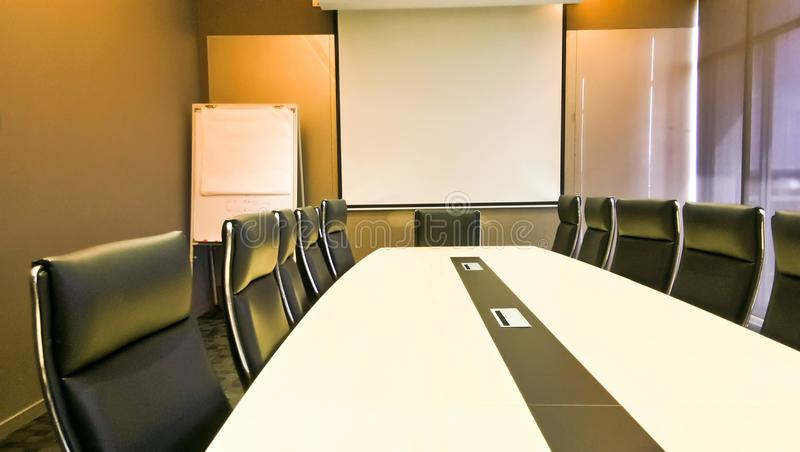 Conference or meeting room with orange lighting as backdrope stock photography