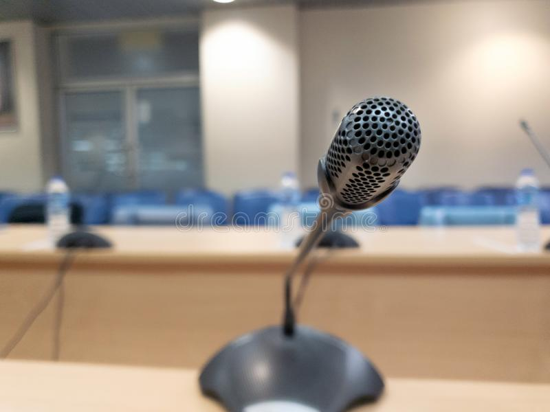 Conference microphones in a meeting room blurred background stock photo