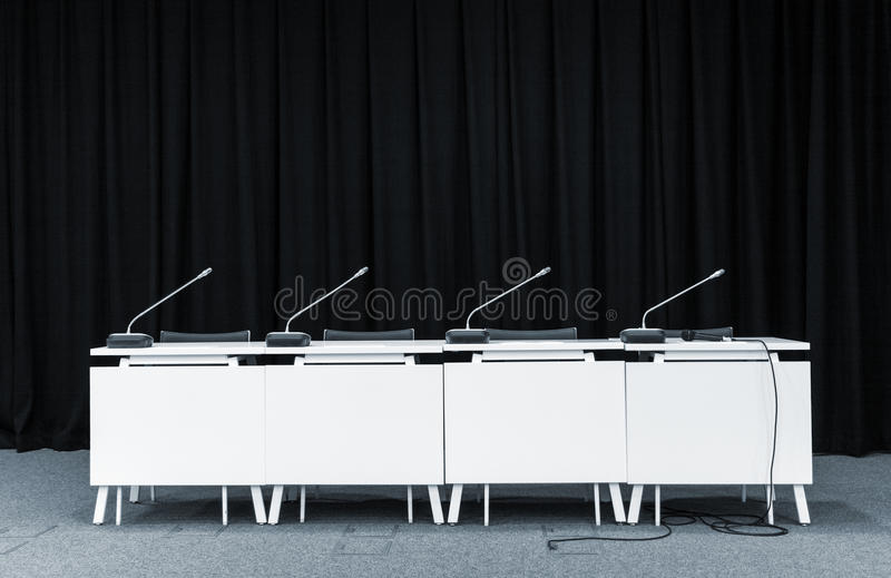 Conference microphones in a meeting room stock images