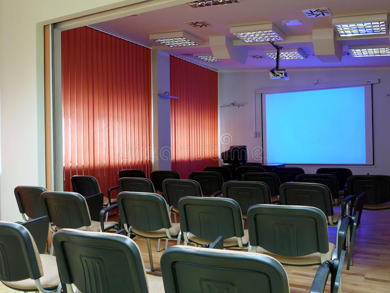 Conference room. Empty conference room with blank projector screen
