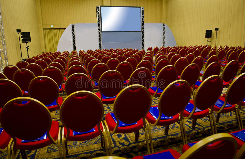 Conference room. With chairs and big screen royalty free stock photography