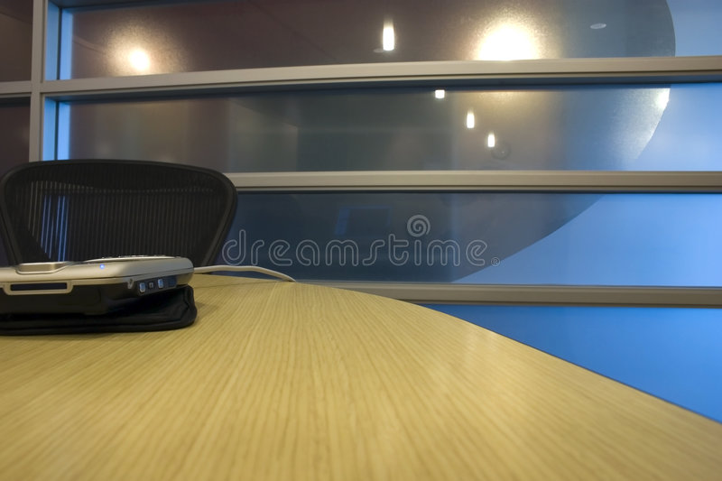 Conference Room with PDA on the Table royalty free stock photography