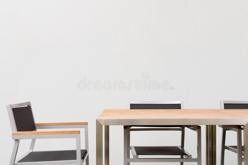 Conference room with place for drawing on wall. Closeup of modern office. White poster on wall royalty free stock photo