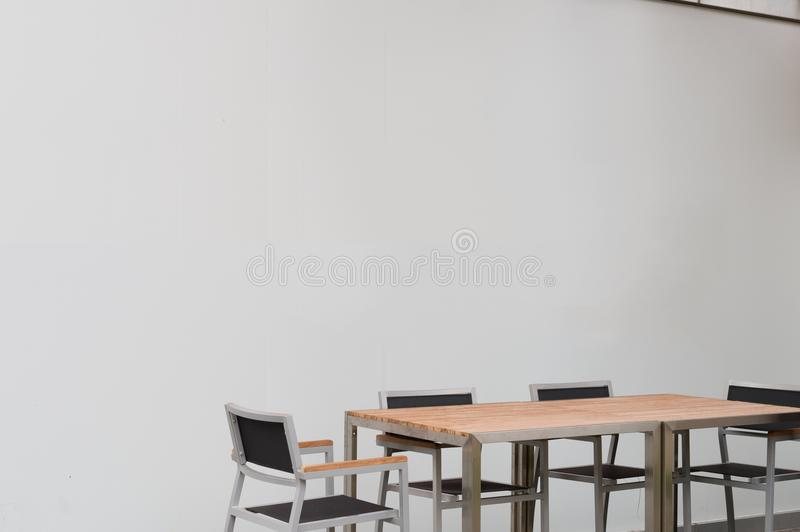 Conference room with place for drawing on wall. Closeup of modern office. White poster on wall royalty free stock photos