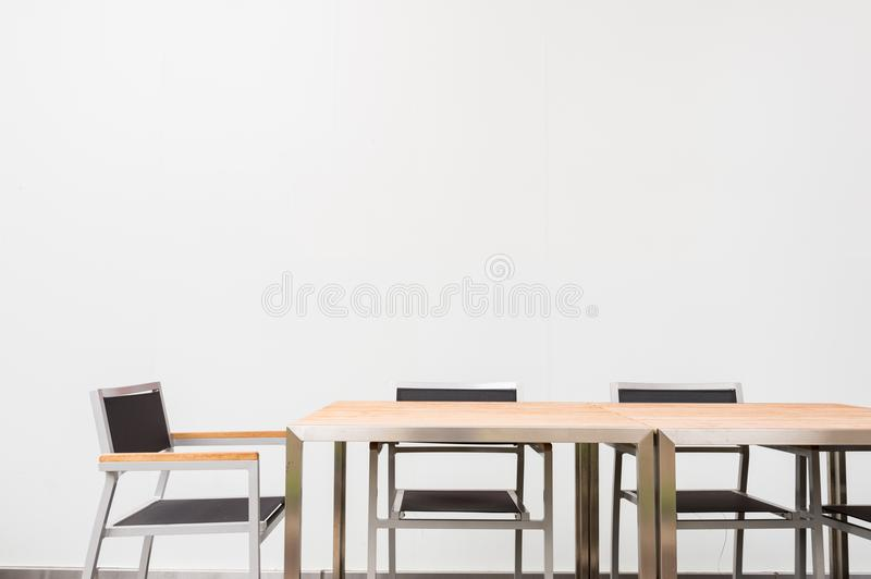 Conference room with place for drawing on wall. Closeup of modern office. White poster on wall royalty free stock image