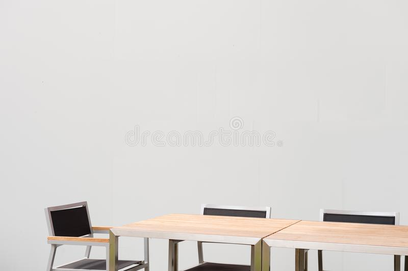 Conference room with place for drawing on wall. Closeup of modern office. White poster on wall stock image