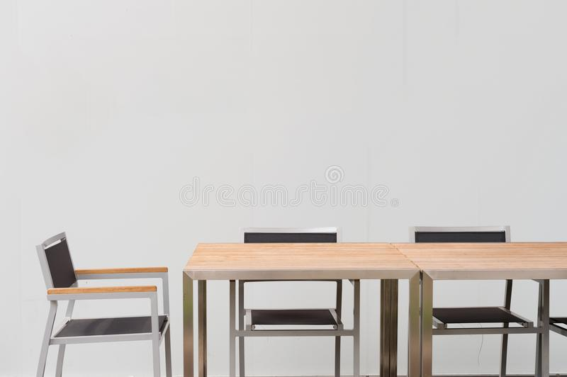 Conference room with place for drawing on wall. Closeup of modern office. White poster on wall royalty free stock photography