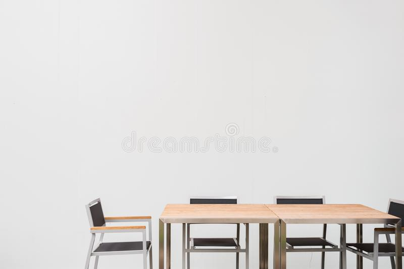 Conference room with place for drawing on wall. Closeup of modern office. White poster on wall royalty free stock images