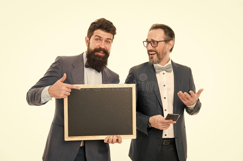 Conference timing. Men successful entrepreneurs on white background. Join our business team. Business people concept. Men bearded guys wear formal suits. Well royalty free stock photo