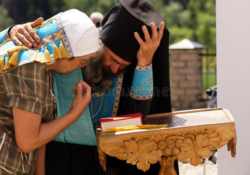 Confession. 5 July 2013 ,the city Krasnousolsk , Bashkortostan,Russia . The feast of the Tabynsk icon of the Mother of God - the main Shrine of the believers of stock photos