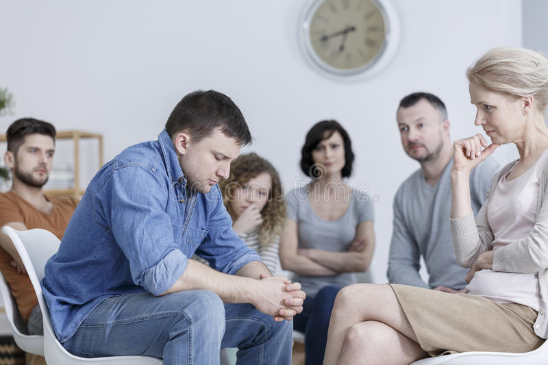 Confession during support group. Man making confession during support group meeting royalty free stock photos