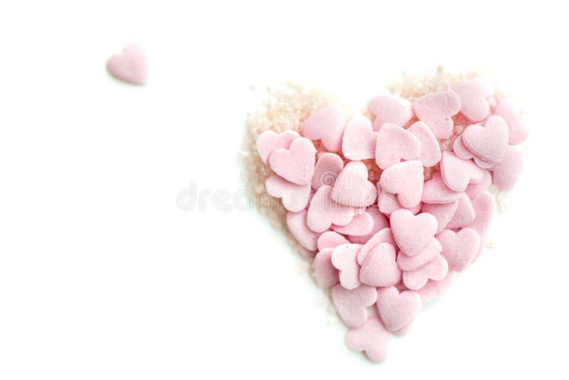 Confetti брызгает в форме сердца стоковое изображение rf