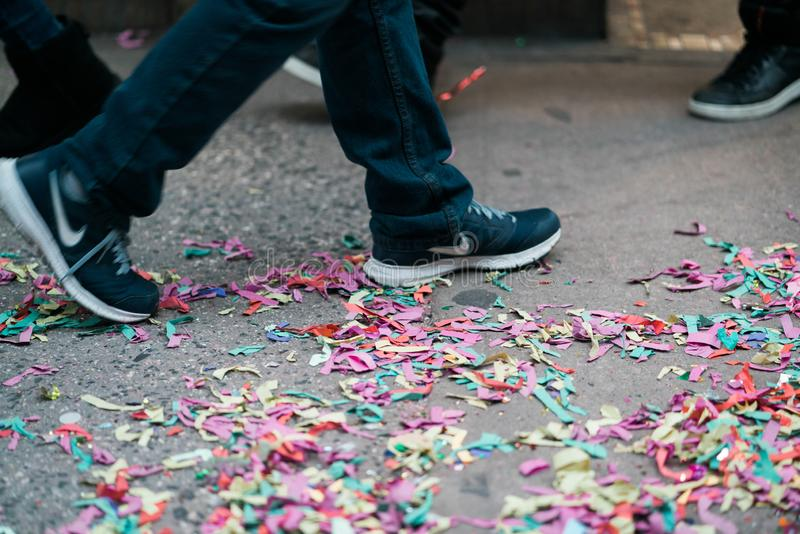 Confetti after a Chinese New Year parade in the City royalty free stock photos