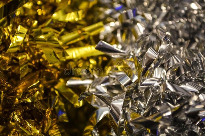 Confetti. Festive ornament, a decor from new years rain. Birthday. Background or texture. Bright silver and gold colors. Holidays. Confetti. Festive ornament, a stock photos