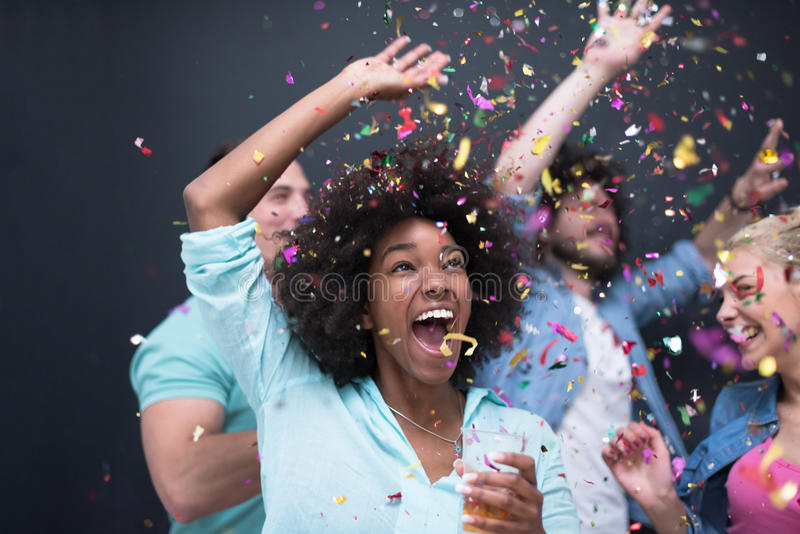 Confetti party multiethnic group of people royalty free stock photo