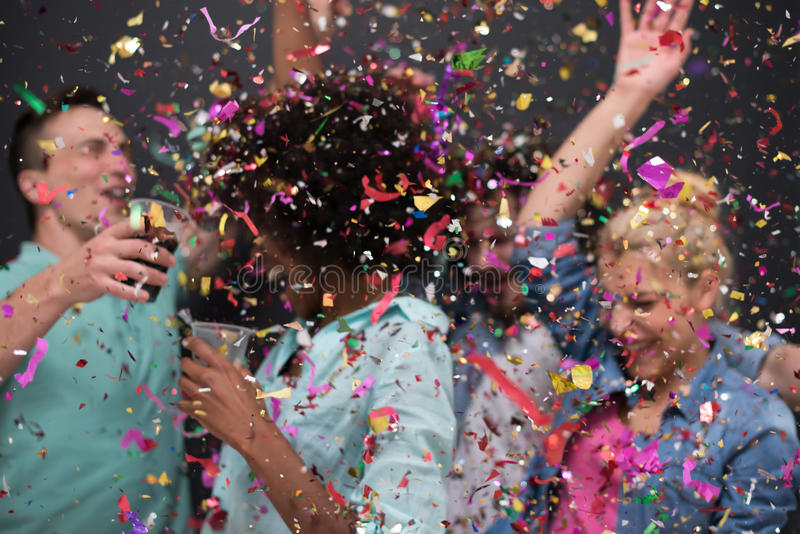 Confetti party multiethnic group of people royalty free stock photography