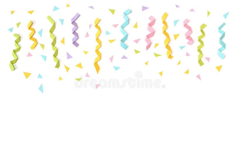 Confetti and ribbon paper cut on white background stock photo