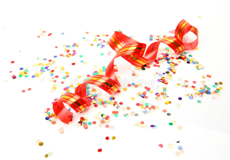 Confetti and streamer. A white background royalty free stock photo