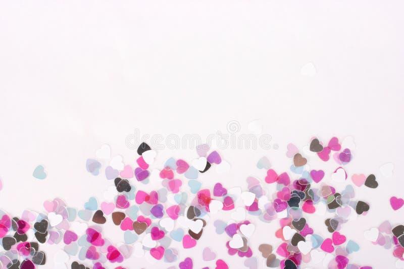 Confettis de coeur horizontaux photo stock