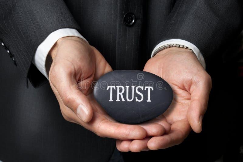 A confiança entrega o ética comercial foto de stock