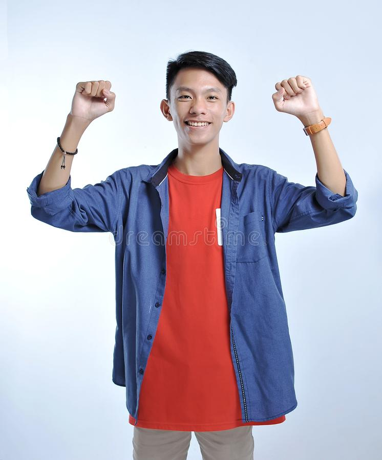 Confidence Asian young man wear casual t-shirts with confident smiling stock image