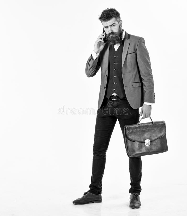 Confidence, business, surprise, news concept. Boss with long beard wearing smart suit and talking phone. Project manager. With surprised face, smartphone and stock photography