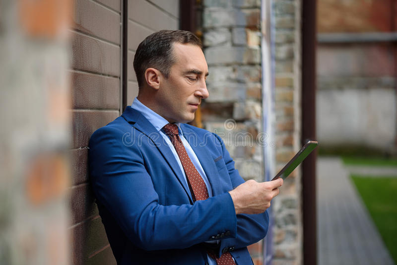 Confidence businessman having rest with technology stock photo