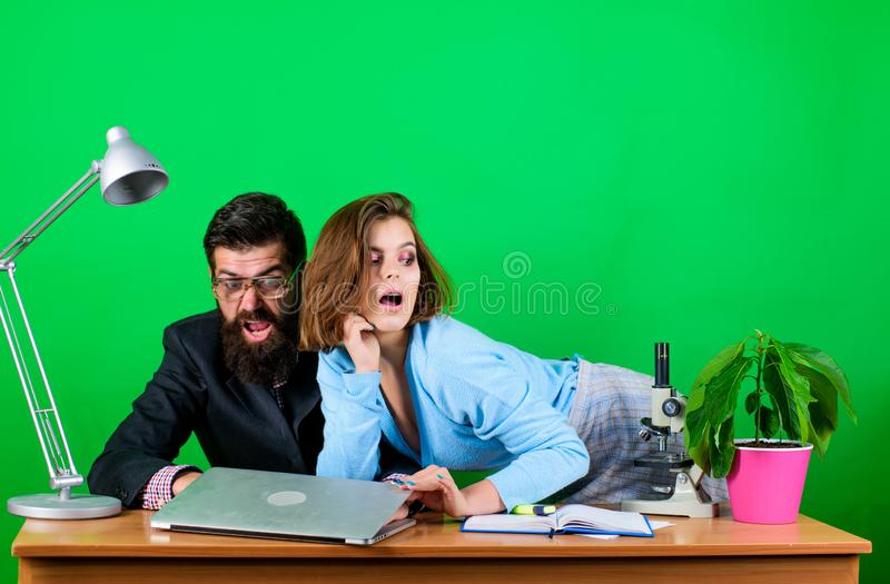 Confidence and charisma. secretary with boss at workplace. woman and man work in office at laptop. businessman and royalty free stock photo