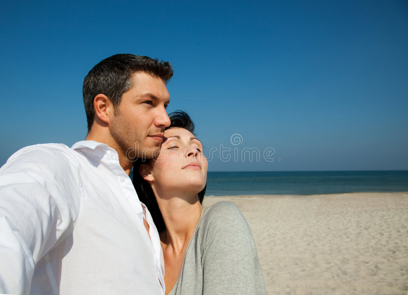 Confidence couple. Mid adult couple on beach looking for security stock photography