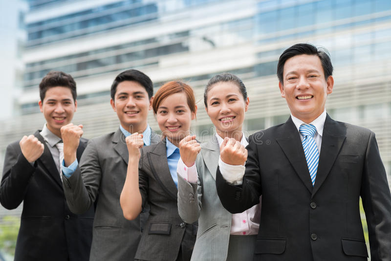 Confidence in everything. Portrait of a confident business team showing fist at camera royalty free stock photography