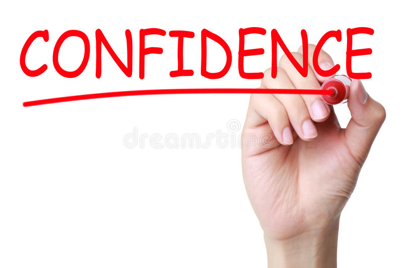 Confidence Headline. Hand with red marker writing confidence headline on transparent board stock images