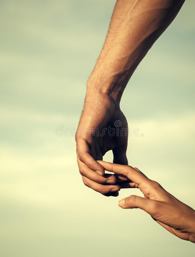 Confidence. mutual assistance. Two hands touching fingers on cloudy sky. Relationship and togetherness concept royalty free stock photo