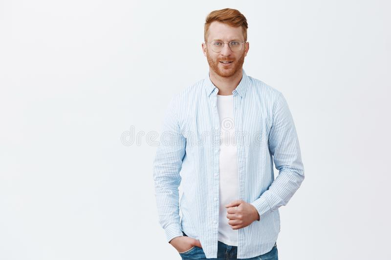 Confidence is new sexy. Portrait of handsome self-assured successful redhead male entrepreneur in shirt and glasses. Holding collar and smiling with charming stock photography