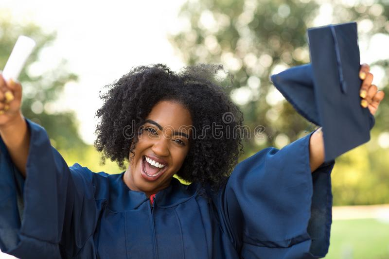 Confident African American woman at her graduation. royalty free stock photography