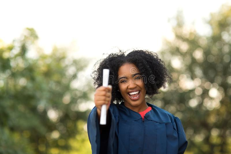 Confident African American woman at her graduation. royalty free stock image