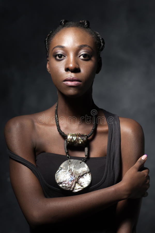 Confident African woman with an ethnic necklace stock photos