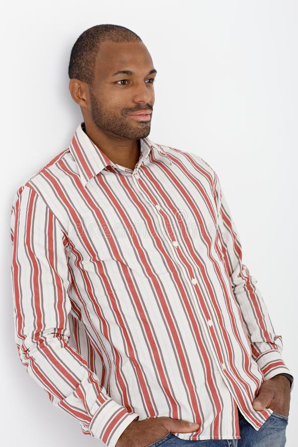 Download Confident Afro-American Guy Posing At Wall Royalty Free Stock Images - Image: 23376209