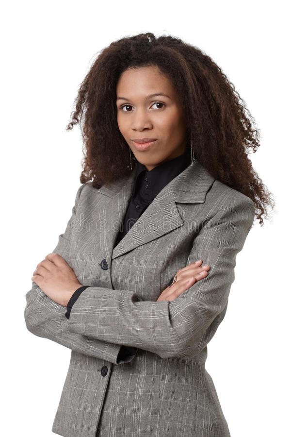 Confident afro businesswoman in suit stock photo