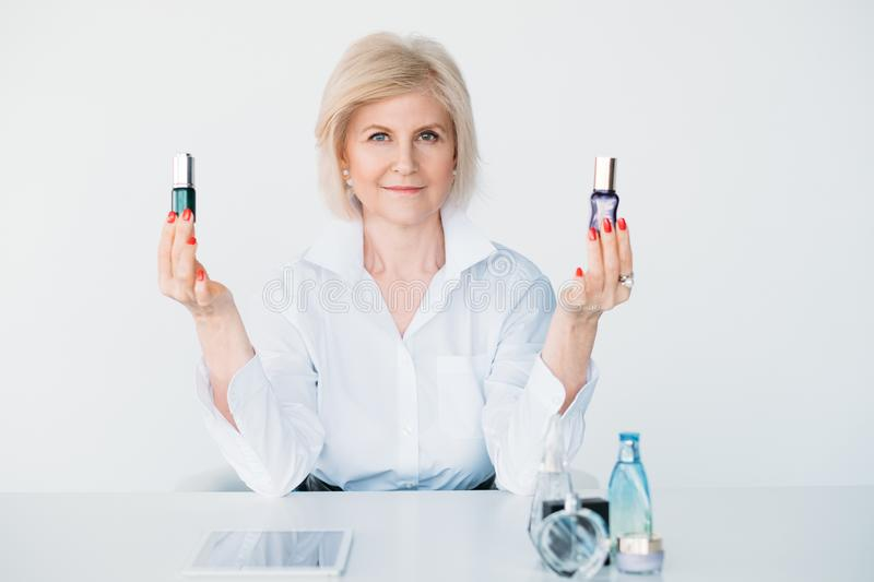 Confident aged lady beauty products choice advice royalty free stock images