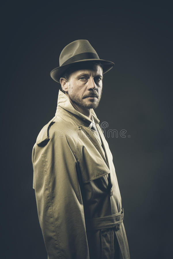 Confident agent in trench coat, film noir stock images