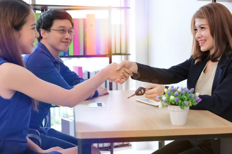 Confident Asian business female shaking hands with partners after finishing a meeting. Handshake greeting deal concept royalty free stock image