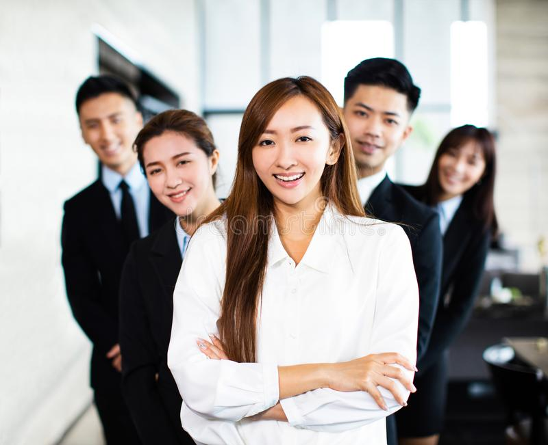 Confident business team stands in office royalty free stock image