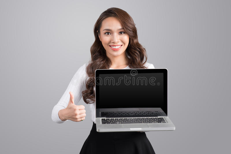 Confident asian business woman showing laptop screen. royalty free stock photo