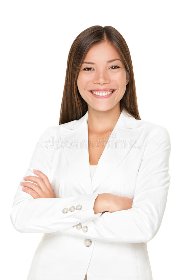Confident Asian businesswoman. Confident smiling young Asian businesswoman in a stylish white suit standing with her arms folded isolated on white royalty free stock photography