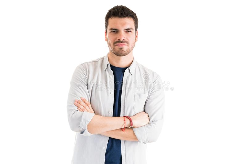 Young Man With Arms Crossed In Studio stock photography